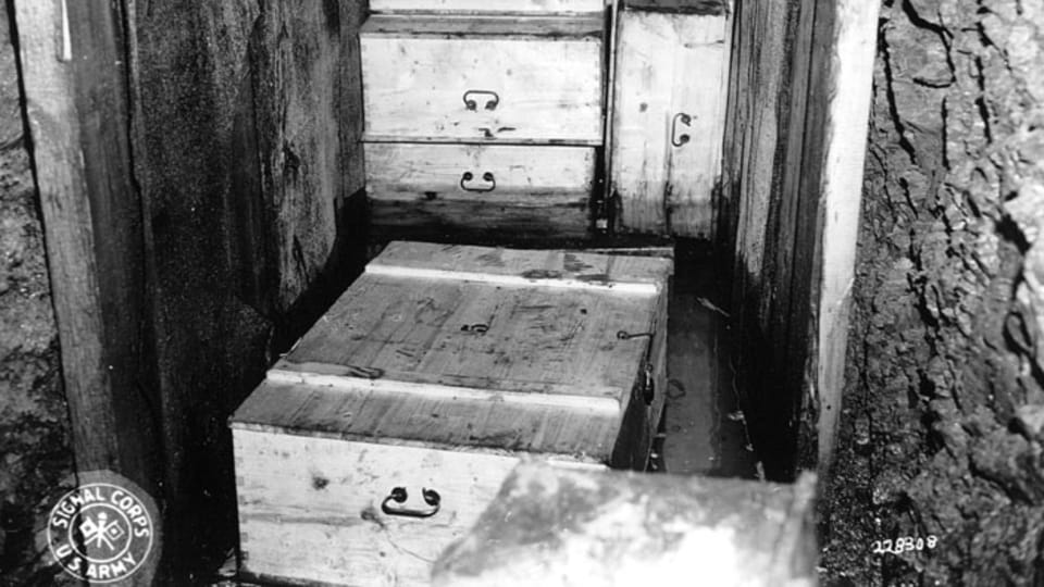 An inside view of the cave shows the manner in which the boxes were packed. Cans of dynamite were planted between the crates as booby traps.  (111-SC-228308),  photo: US National Archives