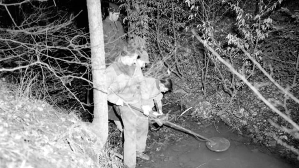 The approach to the cave was swept by a mine detector. No mines were found.  (111-SC-228306),  photo: US National Archives