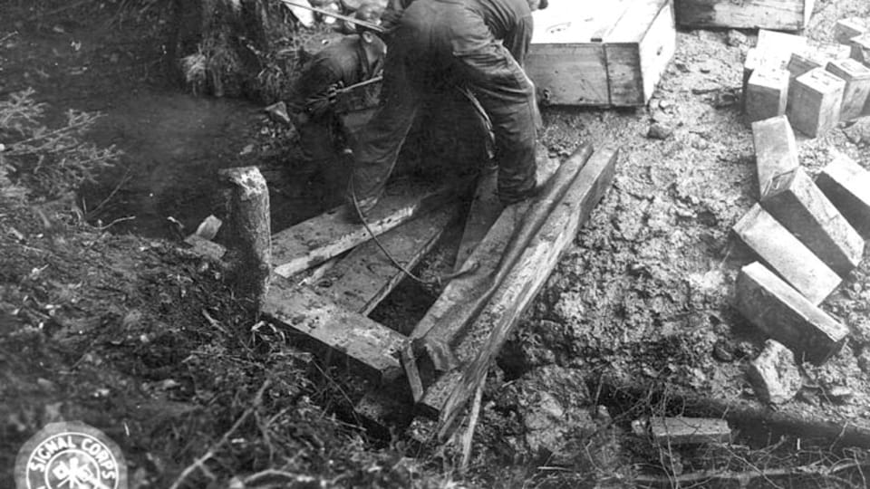 To pull the boxes up the steep ravine,  the team tied rope around each box and pulled it up about 100 yards by winch.  (111-SC-228305),  photo: US National Archives