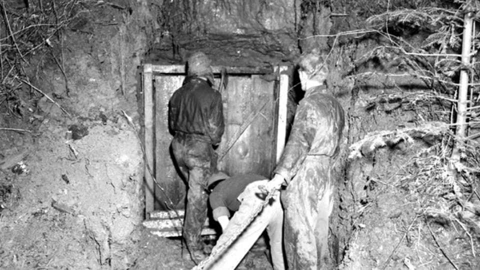 While pulling off the top arch of the cave entrance,  the team discovered a series of cords running to detonators.  (111-SC-229097s),  photo: US National Archives